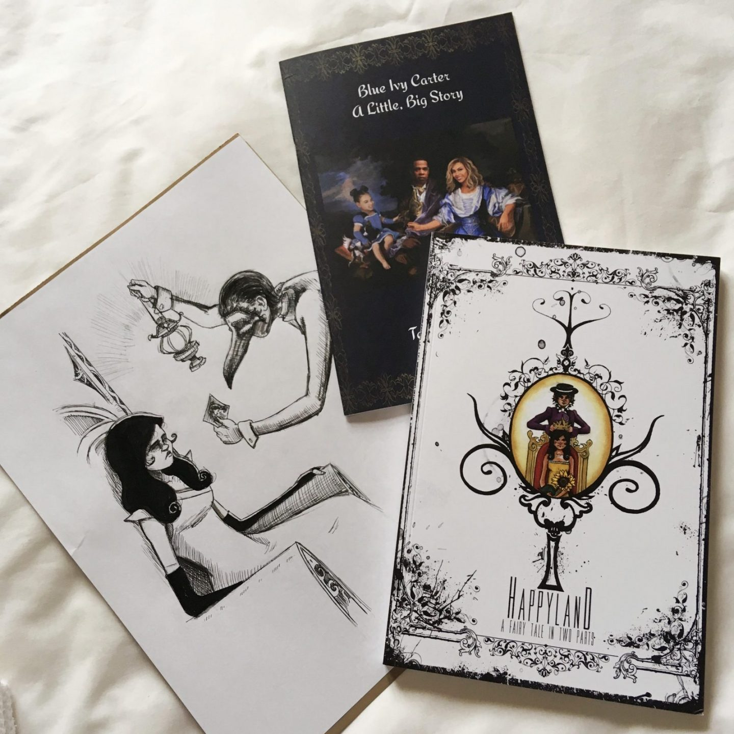 copy of Happyland, Blue Ivy Carter, and original illustration from book