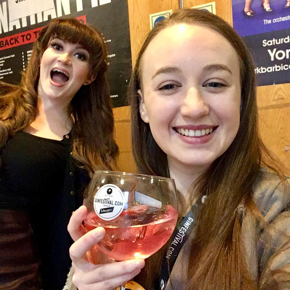selfie of Pippa and Izzy holding gin and smiling