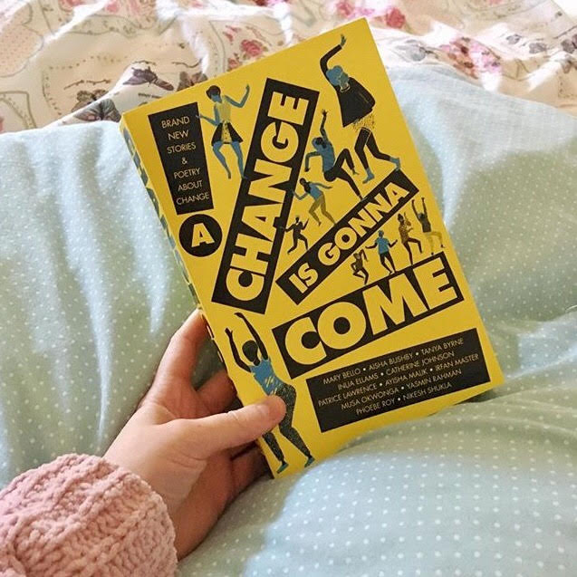 yellow cover of 'a change is gonna come', against a blue bedspread