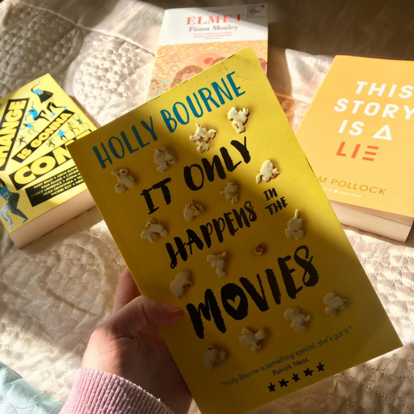 yellow cover of 'it only happens in the movies' by holly bourne