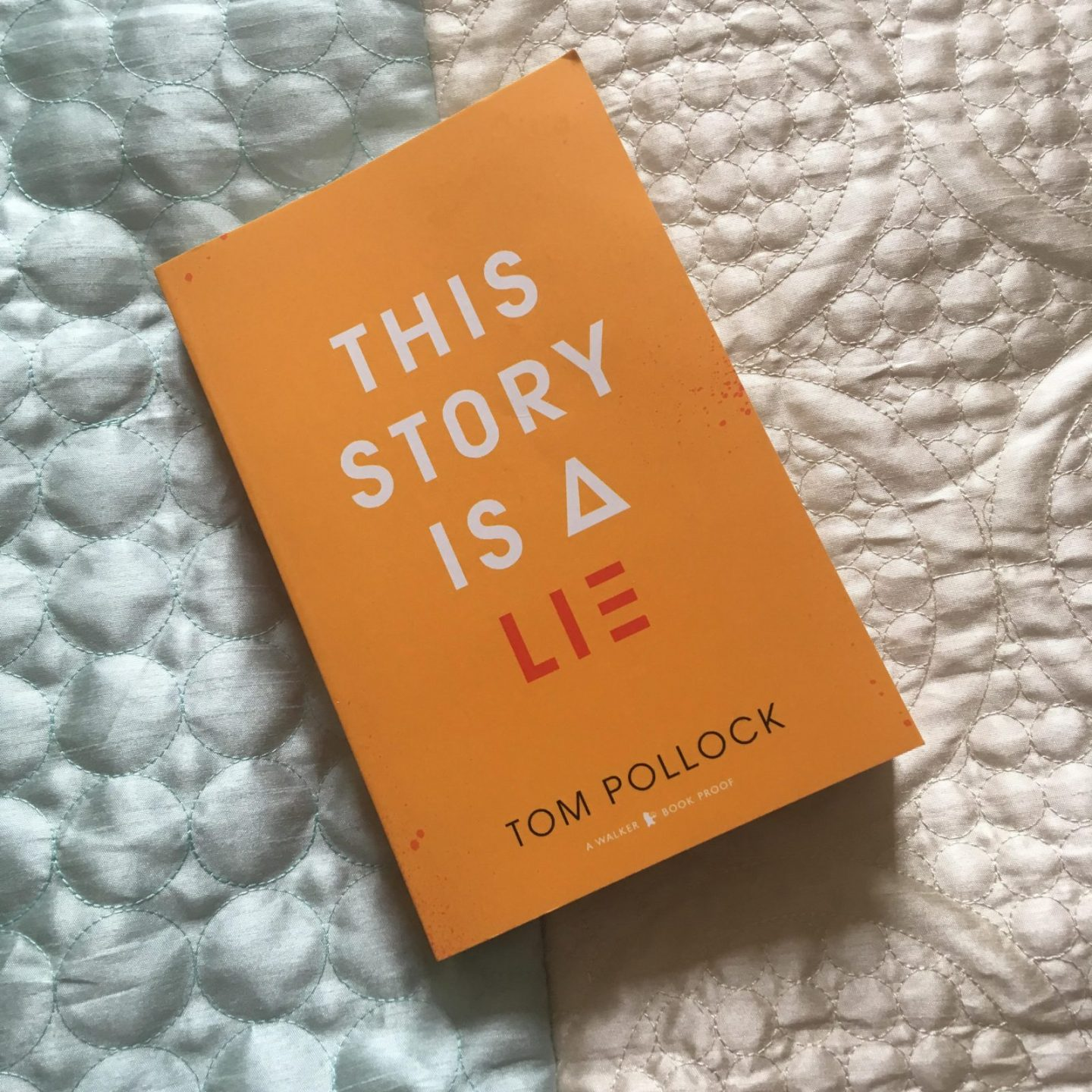 orange book cover reading 'this story is a lie'