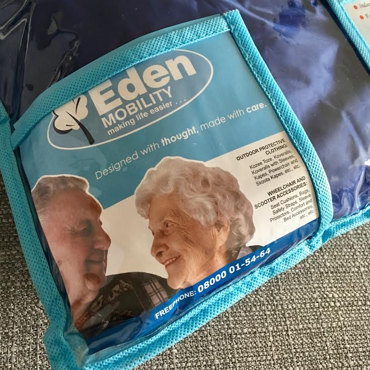 wheelchair cover packaging featuring elderly couple on label