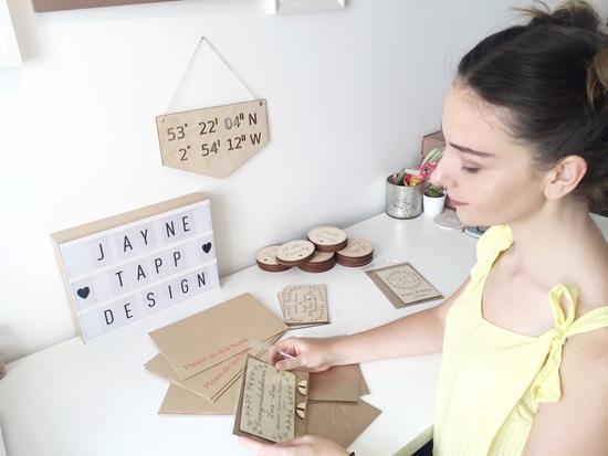 Jayne sat at a desk working on her crafts
