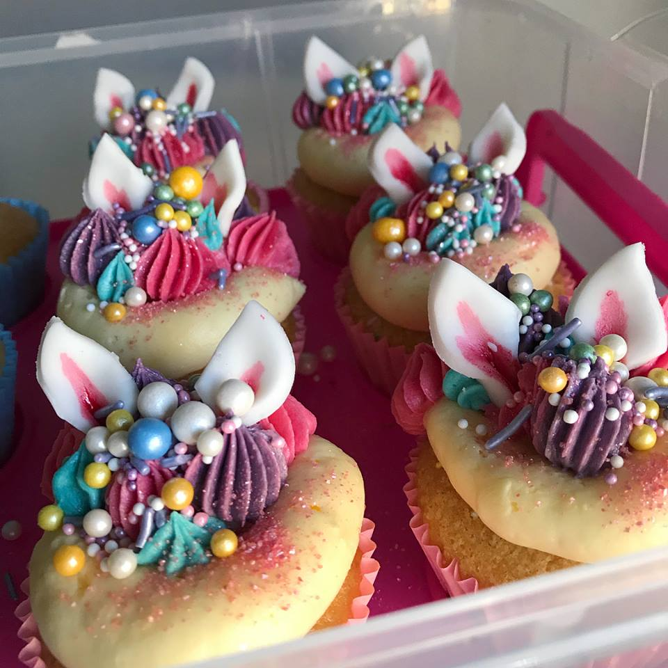 cupcakes decorated with sprinkles to look like unicorns