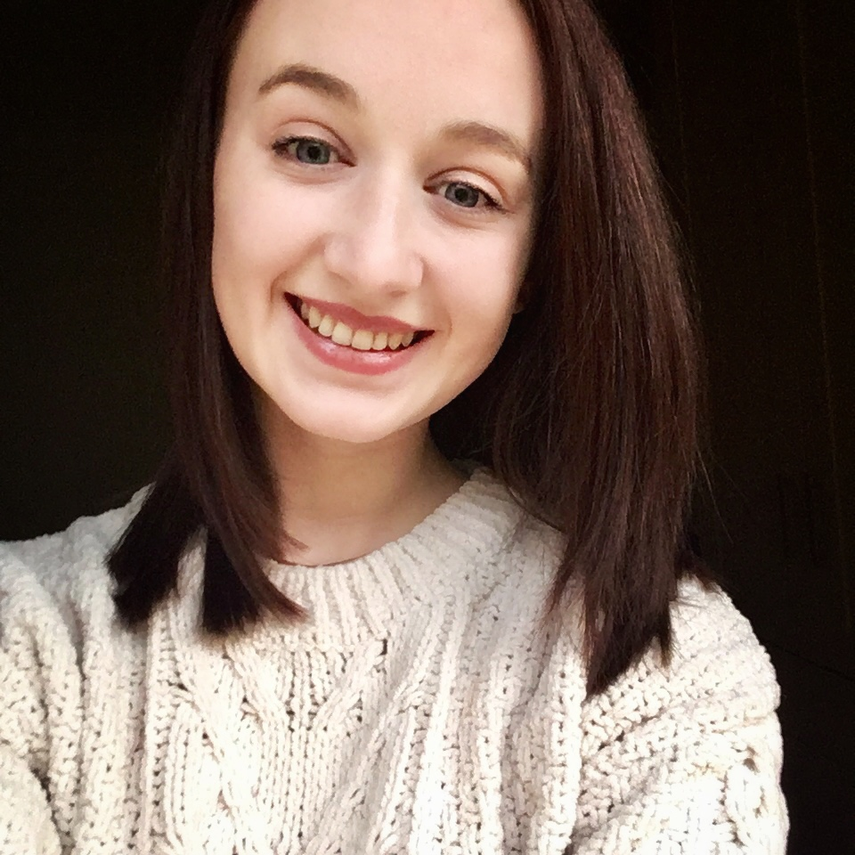 selfie of pippa in cream jumper with short brown hair, smiling