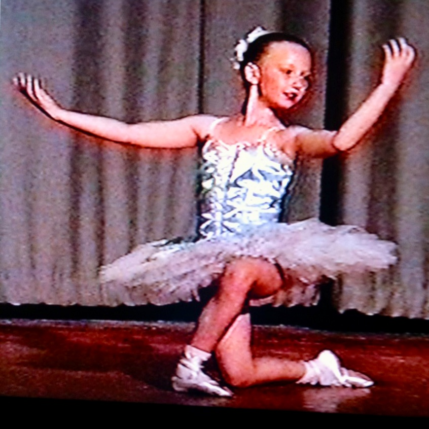 on stage image of pippa aged 9 or 10, dancing, weaing pale blue tut and white satin ballet shoes