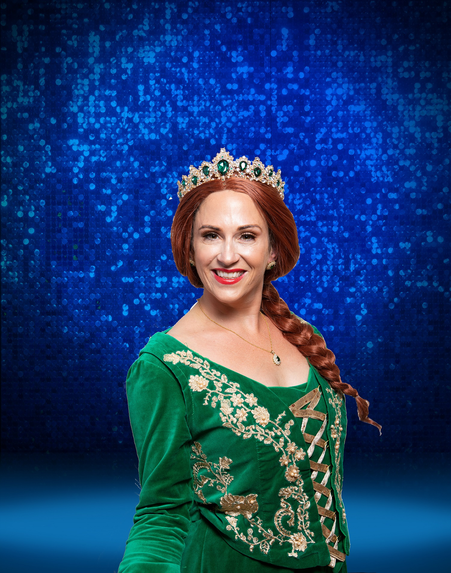cast headshit of princess fiona, wearing crown and green gown, red hair in a long plait