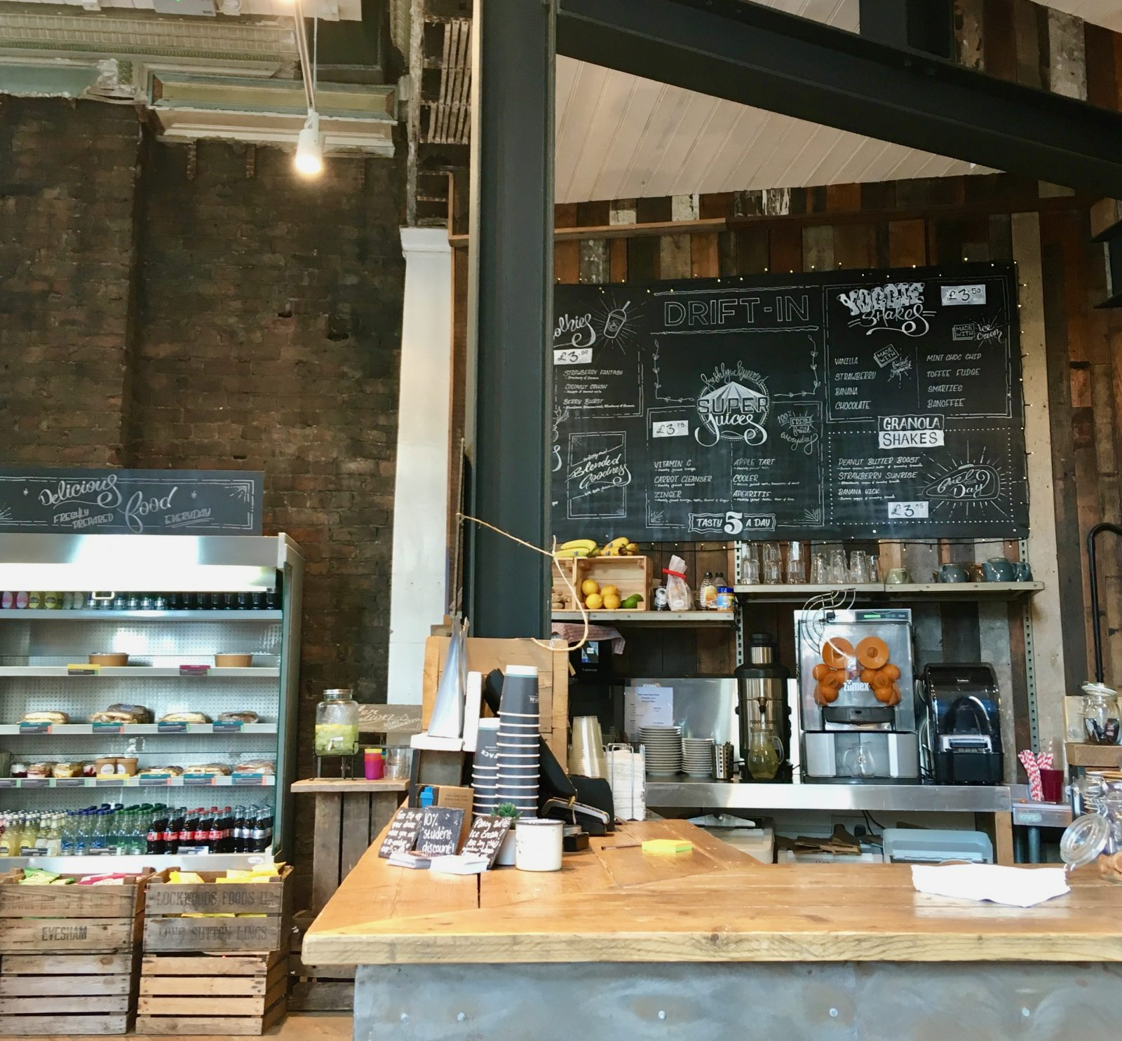 interior of drift in york, featuring counter and blackboard menu along with snacks