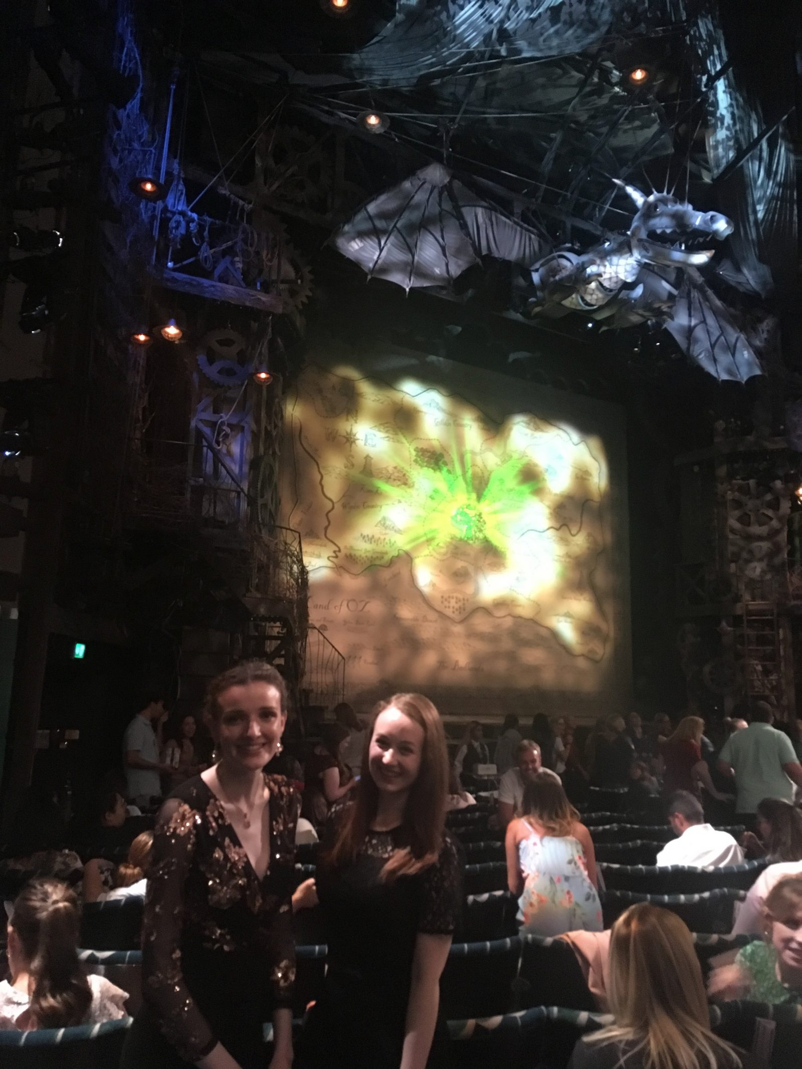 kate and pippa stood in stalls seats in theatre, with wicked stage in background