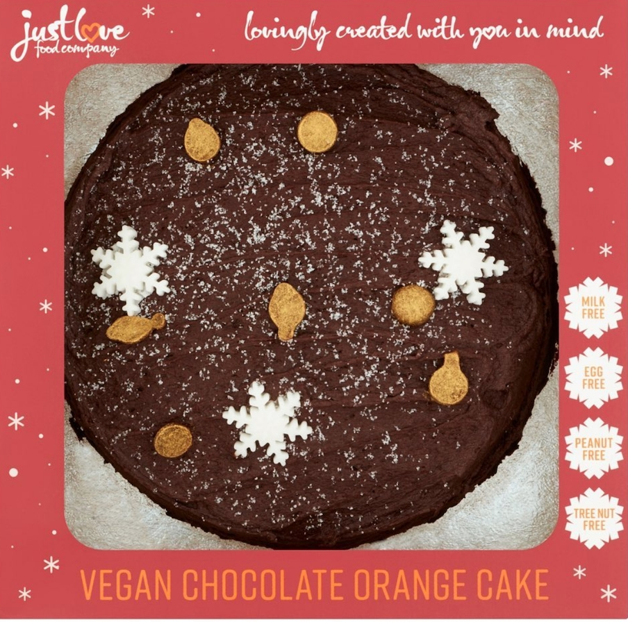 stock image of just love food company's chocolate orange vegan cake, decorated with orange drops and icing snowflakes and packaged in red box